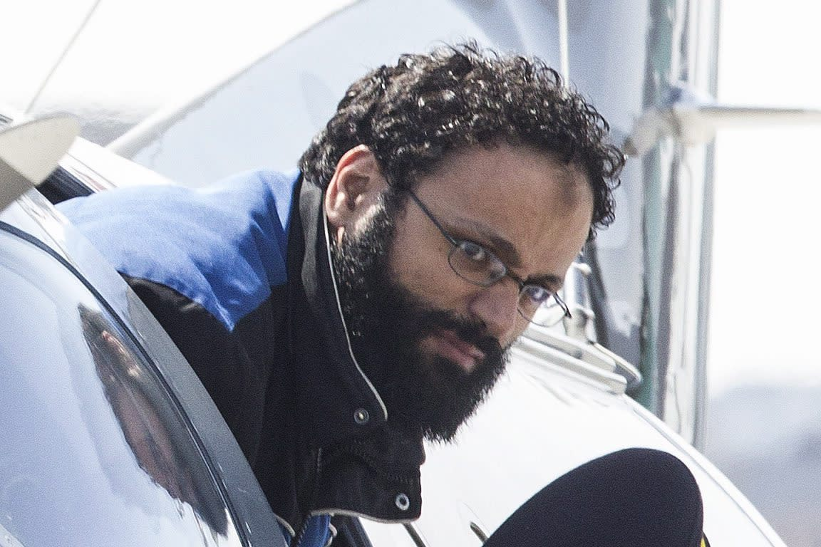 "Chiheb Esseghaier, one of two suspects accused of plotting with al-Qaida in Iran to derail a train in Canada, arrives at Buttonville Airport just north of Toronto, on Tuesday, April 23, 2013. Canadian investigators say Raed Jaser, 35, and his suspected accomplice Esseghaier, 30, received ""directions and guidance"" from members of al-Qaida in Iran. In a brief court appearance in Montreal Tuesday, Esseghaier declined to be represented by a court-appointed lawyer. He made a brief statement in French in which he called the allegations against him unfair. (AP Photo/The Canadian Press, Chris Young)"