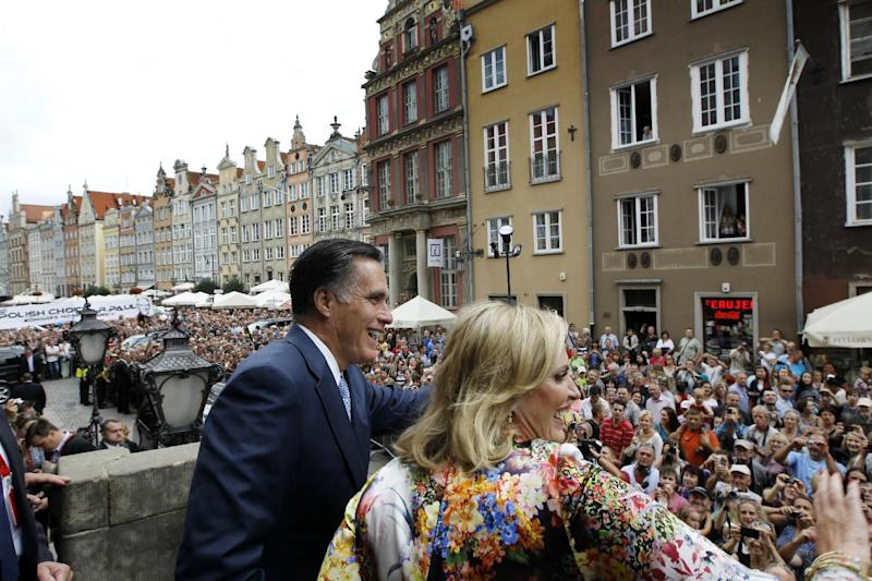Republican presidential candidate, former Massachusetts Gov. Mitt Romney and wife Ann wave to the crowd at The Gdansk Old Town Hall, in Gdansk, Poland, Monday, July 30, 2012. (AP Photo/Charles Dharapak)