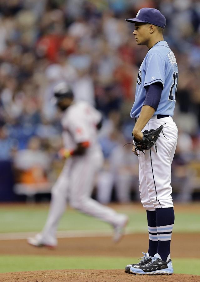 Tampa Bay Rays starting pitcher Chris Archer, right, waits as Boston Red Sox's David Ortiz, background left, rounds the bases after hitting a three-run home run during the third inning of a baseball game Sunday, July 27, 2014, in St. Petersburg, Fla. (AP Photo/Chris O'Meara)