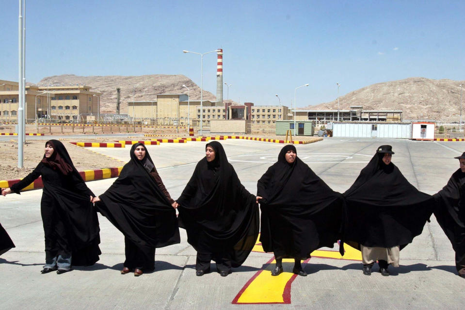 FILE - In this Aug. 16, 2005 file photo, Iranian women form a human chain, at the Isfahan Uranium Conversion Facility, in support of Iran's nuclear program, just outside the city of Isfahan, Iran, 410 kilometers (255 miles) south of the capital Tehran. As Iran prepares to vote Friday, June 18, 2021, for a new president, its tattered nuclear deal for world powers hangs in the balance as diplomats try to find a way to get both the U.S. and Tehran to reenter the accord. (AP Photo/Vahid Salemi, File)