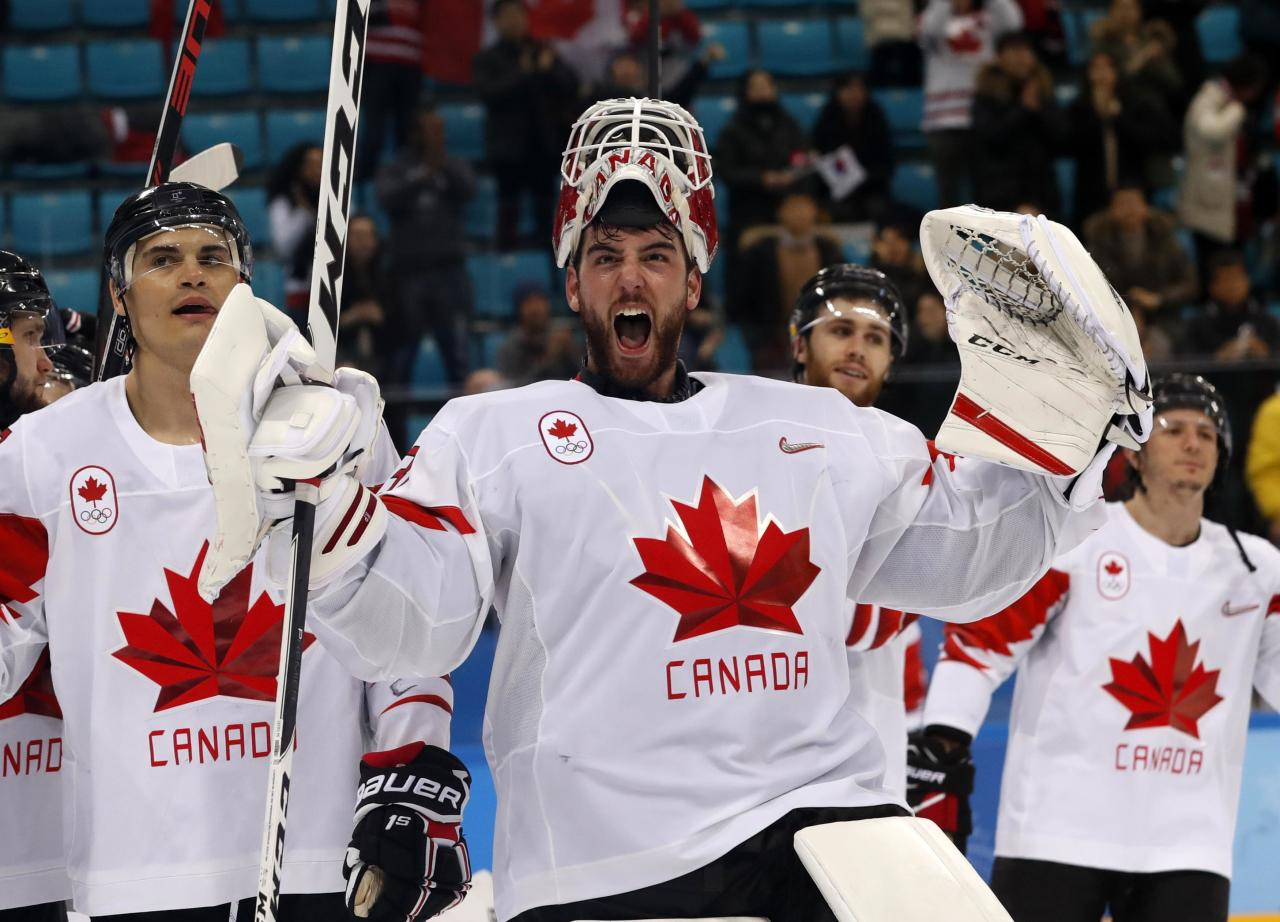 Ice Hockey - Pyeongchang 2018 Winter Olympics - Men's Bronze Medal Match - Czech Republic v Canada - Gangneung Hockey Centre, Gangneung, South Korea - February 24, 2018 - Goalie Kevin Poulin of Canada celebrates with teammates following their bronze medal victory. REUTERS/Kim Kyung-Hoon TPX IMAGES OF THE DAY