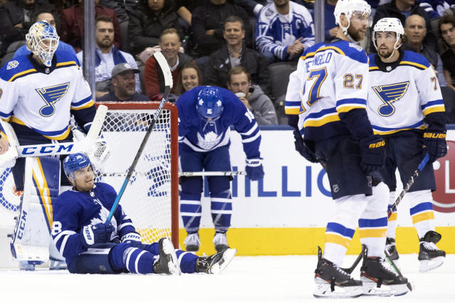 Toronto Maple Leafs left wing Andreas Johnsson (18) sits on the ice following a play during third-period NHL hockey game action against the St. Louis Blues in Toronto, Monday, Oct. 7, 2019. (Chris Young/The Canadian Press via AP)