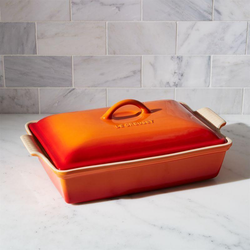 """<p><strong>le-creuset</strong></p><p>crateandbarrel.com</p><p><strong>$115.00</strong></p><p><a href=""""https://go.redirectingat.com?id=74968X1596630&url=https%3A%2F%2Fwww.crateandbarrel.com%2Fle-creuset-heritage-covered-rectangle-flame-baking-dish%2Fs625675&sref=https%3A%2F%2Fwww.thepioneerwoman.com%2Ffood-cooking%2Fg36522958%2Fbest-casserole-dishes%2F"""" rel=""""nofollow noopener"""" target=""""_blank"""" data-ylk=""""slk:Shop Now"""" class=""""link rapid-noclick-resp"""">Shop Now</a></p><p>Le Creuset is synonymous with quality bakeware and when you break down all of its great attributes, it's easy to see why: The enamel-glazed stoneware is safe to go in the dishwasher, freezer, oven, and microwave. Plus, you can find a color to complement nearly any kitchen. </p>"""