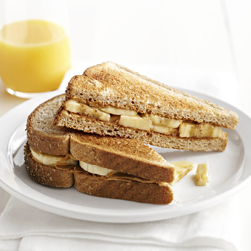"<p>Creamy peanut butter and bananas are the key ingredients to this quick and easy breakfast. <a href=""http://www.eatingwell.com/recipe/262893/peanut-butter-and-banana-breakfast-sandwich/"" rel=""nofollow noopener"" target=""_blank"" data-ylk=""slk:View recipe"" class=""link rapid-noclick-resp""> View recipe </a></p>"