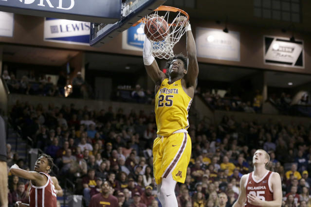 Minnesota's Daniel Oturu (25) dunks as Oklahoma's Alondes Williams (15) and Brady Manek (35) watch during the second half of an NCAA college basketball game in Sioux Falls, S.D., Saturday, Nov. 9, 2019. (AP Photo/Nati Harnik)