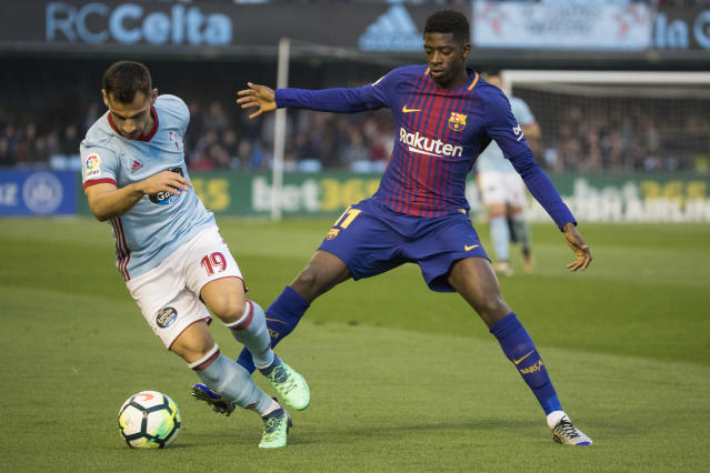 RC Celta's Jonny Otto, left, challenges for the ball with Barcelona's Ousmane Dembele during a Spanish La Liga soccer match between RC Celta and Barcelona at the Balaidos stadium in Vigo, Spain, Tuesday April 17, 2018. (AP Photo/Lalo R. Villar)