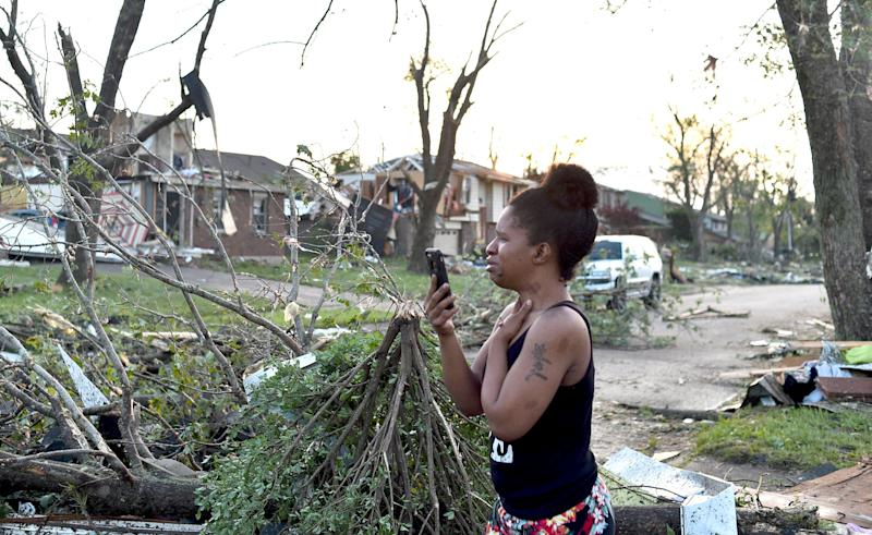 Residents of the West Brook neighborhood of Trotwood, Ohio, inspect the damage to their homes following powerful tornadoes on May 28. (Photo: Matthew Hatcher/Getty Images)