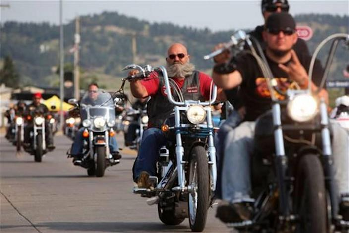 Motorcyclists ride down the street in Sturgis, South Dakota, on opening day of a prior rally.