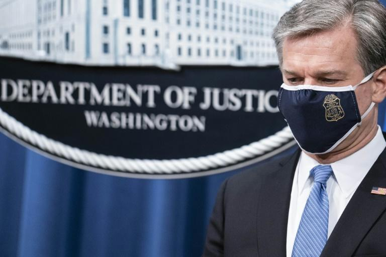 FBI Director Christopher Wray at a press conference announcing the arrst of five Chinese agents for their role in an operation targeting opponents of the Chinese government