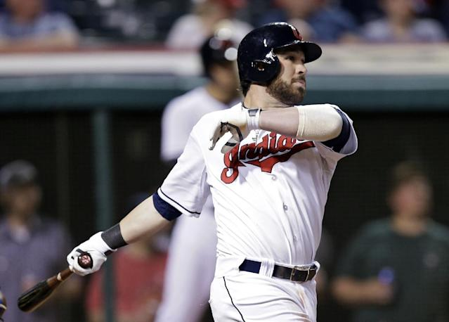 Cleveland Indians' Jason Kipnis watches his two-run home run off Kansas City Royals starting pitcher Jeremy Guthrie in the sixth inning of a baseball game Monday, April 21, 2014, in Cleveland. (AP Photo/Mark Duncan)