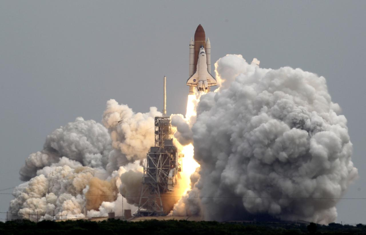 Space shuttle Atlantis lifts off from Pad 39A at the Kennedy Space Center in Cape Canaveral, Fla., Friday, July 8, 2011. The STS135 mission, the final shuttle flight, will bring supplies to the international space station. (AP Photo/John Raoux)
