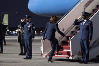 FILE - In this Friday, March 19, 2021 file photo, Vice President Kamala Harris boards Air Force Two upon departure from Dobbins Air Reserve Base in Marietta, Ga. On Friday, March 26, 2021, The Associated Press reported on stories circulating online incorrectly asserting Harris disrespected the military when she failed to salute the military escorts when boarding Air Force Two on March 19 in Georgia. While Harris did not salute the troops, she is not required to. According to Army regulation, the president as the commander-in-chief is required to receive a salute, but there is no requirement that the vice president receive a salute. (AP Photo/Alex Brandon)