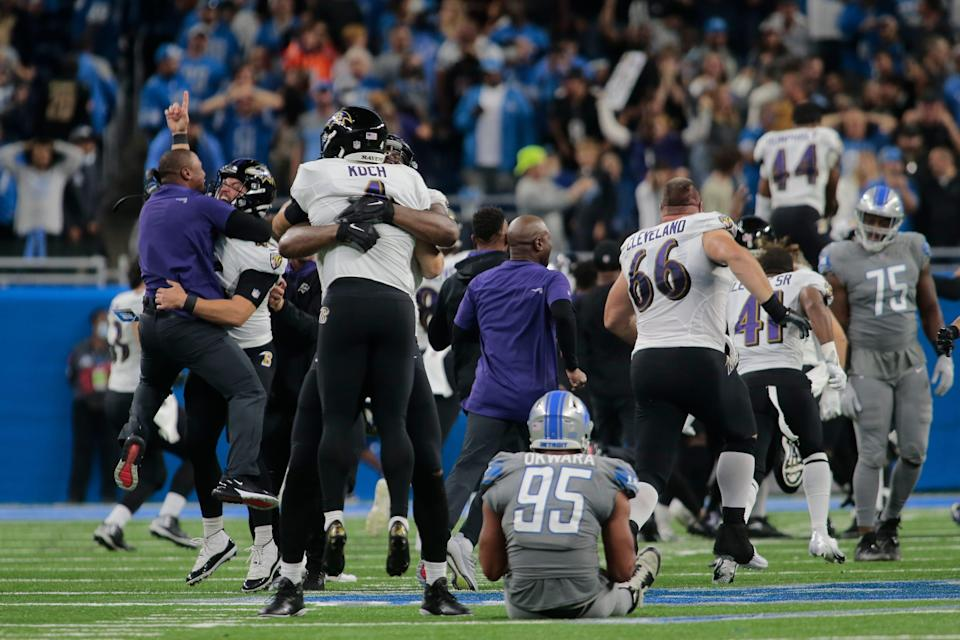 Baltimore Ravens players celebrate a Justin Tucker 66-yard field goal as Detroit Lions linebacker Romeo Okwara (95) sits on the field in the second half of an NFL football game against the Detroit Lions in Detroit, Sunday, Sept. 26, 2021. Baltimore won 19-17.