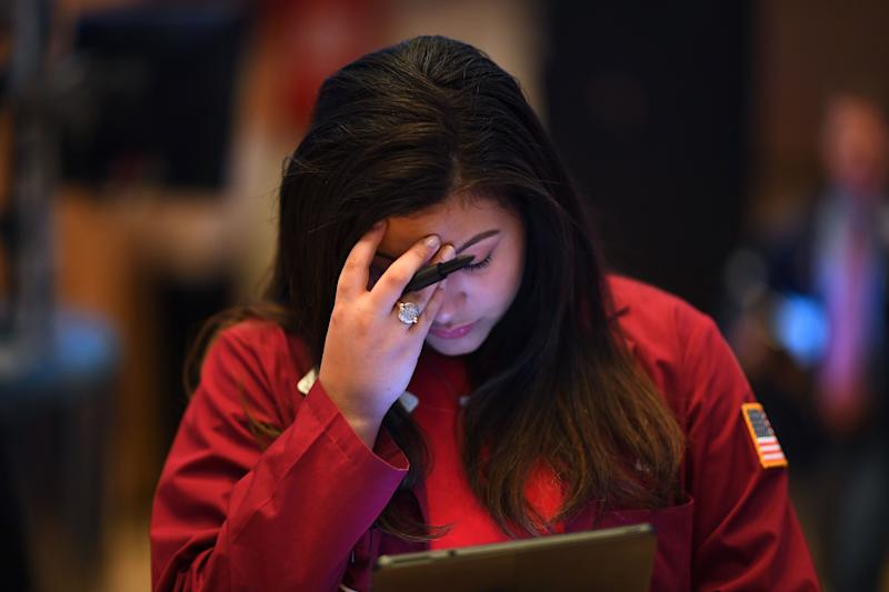 A trader reacts during the opening bell at the New York Stock Exchange (NYSE) on February 28, 2020 at Wall Street in New York City. - Losses on Wall Street deepened following a bruising open, as global markets were poised to conclude their worst week since 2008 with another rout. (Photo by Johannes EISELE / AFP) (Photo by JOHANNES EISELE/AFP via Getty Images)