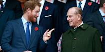 <p>Prince Phillip and Prince Harry share a laugh during the Rugby World Cup Final. </p>