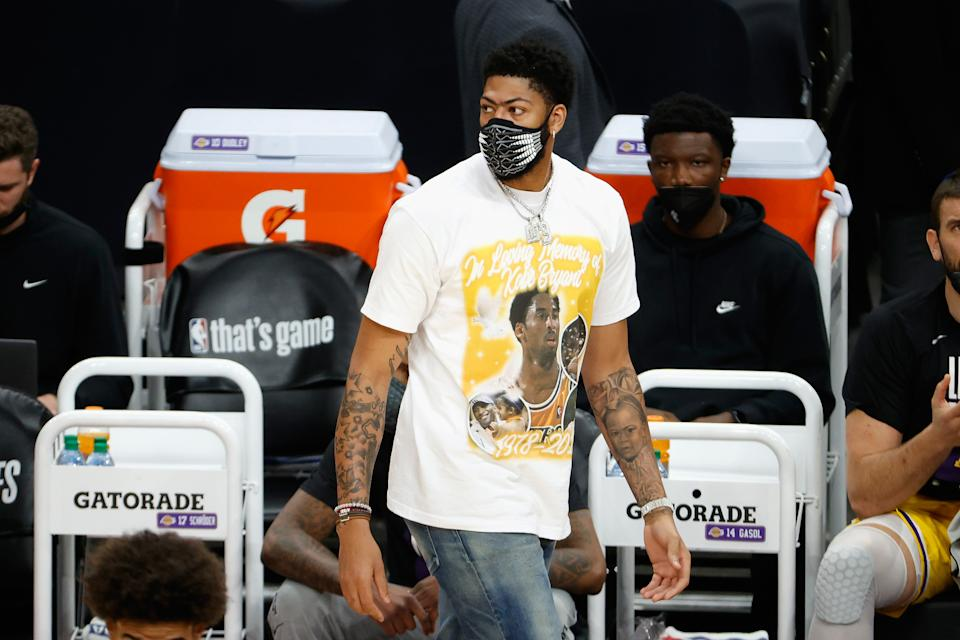 Anthony Davis #3 of the Los Angeles Lakers watches from the bench during the first half in Game Five of the Western Conference first-round playoff series at Phoenix Suns Arena on June 01, 2021 in Phoenix, Arizona. NOTE TO USER: User expressly acknowledges and agrees that, by downloading and or using this photograph, User is consenting to the terms and conditions of the Getty Images License Agreement.  (Photo by Christian Petersen/Getty Images)
