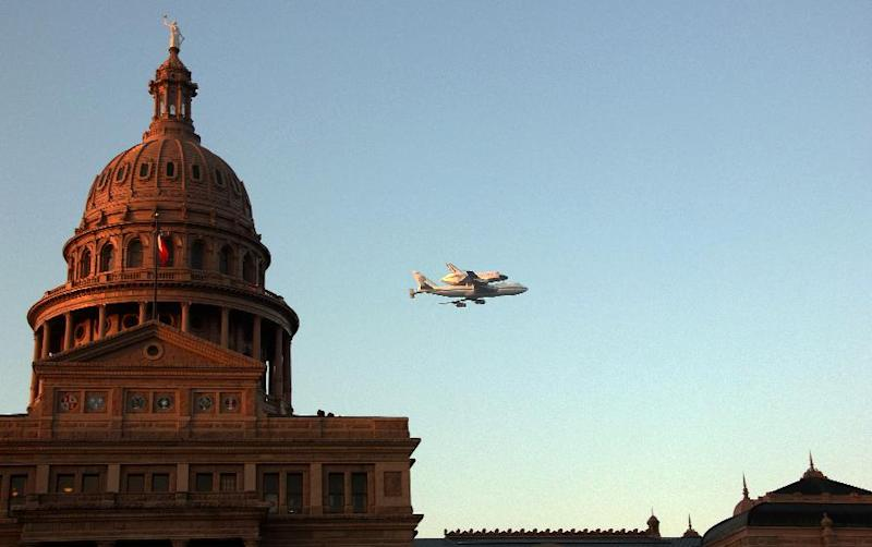 Space Shuttle Endeavour sits atop the shuttle aircraft carrier, flies over downtown Austin, Texas early Thursday, Sept. 20, 2012. Endeavour is making a final trek across the country to the California Science Center in Los Angeles, where it will be permanently displayed. (AP Photo/Marco Hanson)