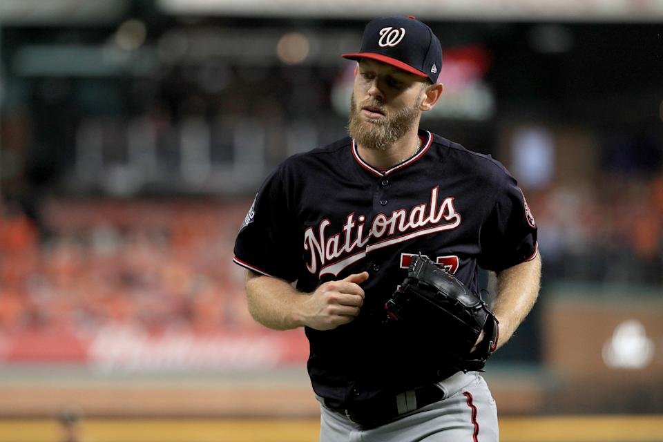 Stephen Strasburg is re-signing with the Nationals, the only team he's ever known. (Mike Ehrmann/Getty Images)