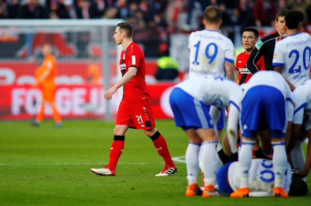 Soccer Football - Bundesliga - Bayer Leverkusen vs Schalke 04 - BayArena, Leverkusen, Germany - February 25, 2018 Bayer Leverkusen's Dominik Kohr is sent off for a challenge on Schalke's Breel Embolo REUTERS/Thilo Schmuelgen DFL RULES TO LIMIT THE ONLINE USAGE DURING MATCH TIME TO 15 PICTURES PER GAME. IMAGE SEQUENCES TO SIMULATE VIDEO IS NOT ALLOWED AT ANY TIME. FOR FURTHER QUERIES PLEASE CONTACT DFL DIRECTLY AT + 49 69 650050