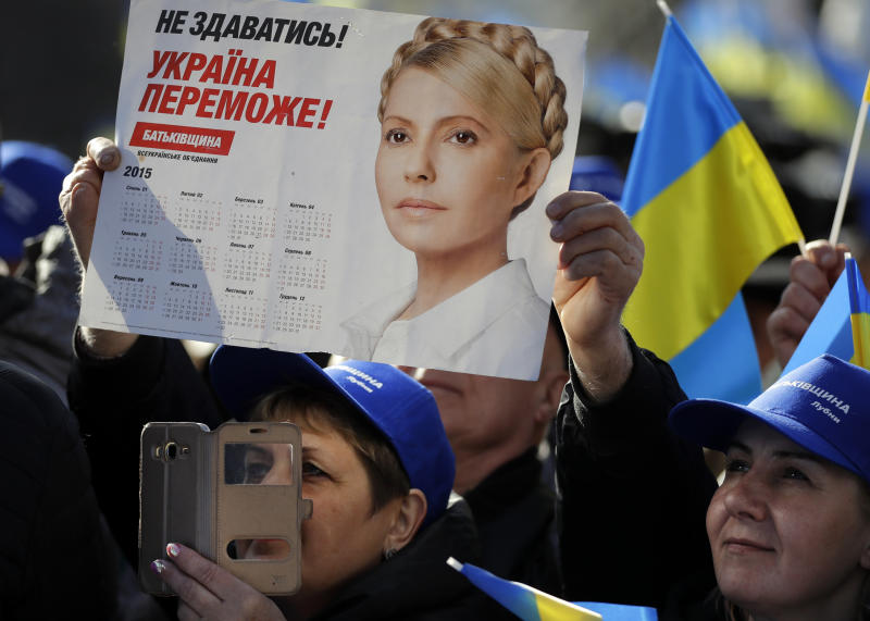 "Supporters greet Former Ukrainian Prime Minister Yulia Tymoshenko, candidate for the 2019 presidential elections, during a rally in Kiev, Ukraine, Friday, March 29, 2019. Tymoshenko is running in the president election scheduled for March 31. The placard reading ""To not give up! Ukraine will win!"" (AP Photo/Sergei Grits)"