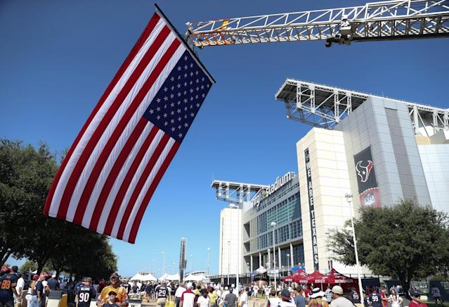 <p>A large American flag is displayed outside of NRG Stadium before the game between the Houston Texans and Chicago Bears. Mandatory Credit: Kevin Jairaj-USA TODAY Sports </p>