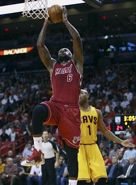 Miami Heat's LeBron James (6) drives around Cleveland Cavaliers' Jarrett Jack (1) for two points during the first half of an NBA basketball game in Miami, Saturday, Dec. 14, 2013. (AP Photo/J Pat Carter)