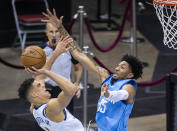 Denver Nuggets forward Michael Porter Jr. (1) tries to shoot over Houston Rockets center Christian Wood (35) during the third quarter of an NBA basketball game Friday, April 16, 2021, in Houston. (Mark Mulligan/Houston Chronicle via AP)