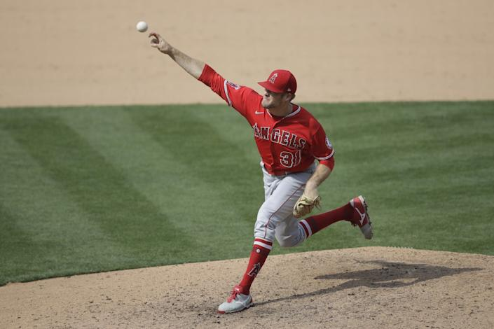 "Angels pitcher Ty Buttrey works against the Athletics during the ninth inning. <span class=""copyright"">(Ben Margot / Associated Press)</span>"