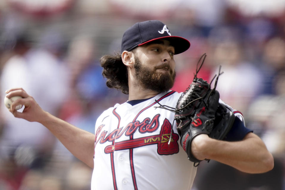 Atlanta Braves starting pitcher Ian Anderson (36) works against the Milwaukee Brewers during the first inning of Game 3 of a baseball National League Division Series, Monday, Oct. 11, 2021, in Atlanta. (AP Photo/Brynn Anderson)