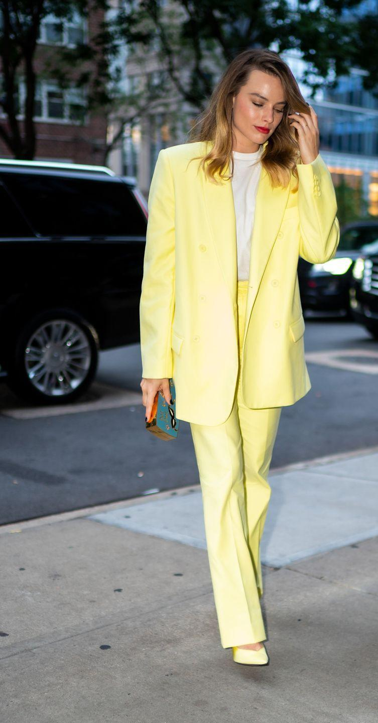 <p>The actress rocked an Eighties-inspired neon yellow power suit from The Attico and a white T-shirt during a day out in New York City.<br></p>