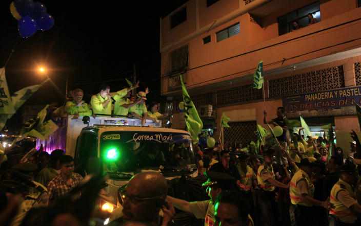 Ecuador's President and candidate for re-election Rafael Correa and vice presidential candidate Jorge Glass greet supporters during a rally in Guayaquil, Ecuador, Wednesday, Feb. 13, 2013. Presidential elections in Ecuador are scheduled for Feb. 17. (AP Photo/Dolores Ochoa)
