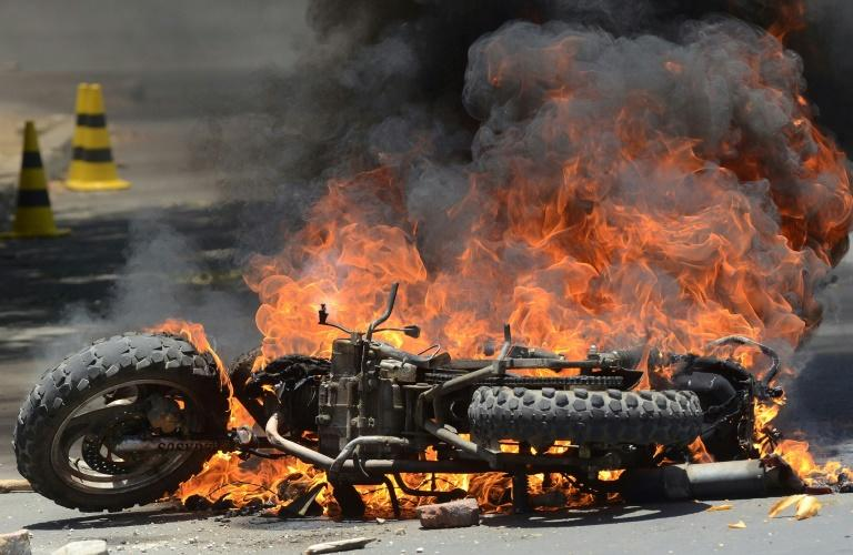 A motorbike burns in Cochabamba, a stronghold of Bolivia President Evo Morales, as clashes between his supporters and those of rival Carlos Mesa continue