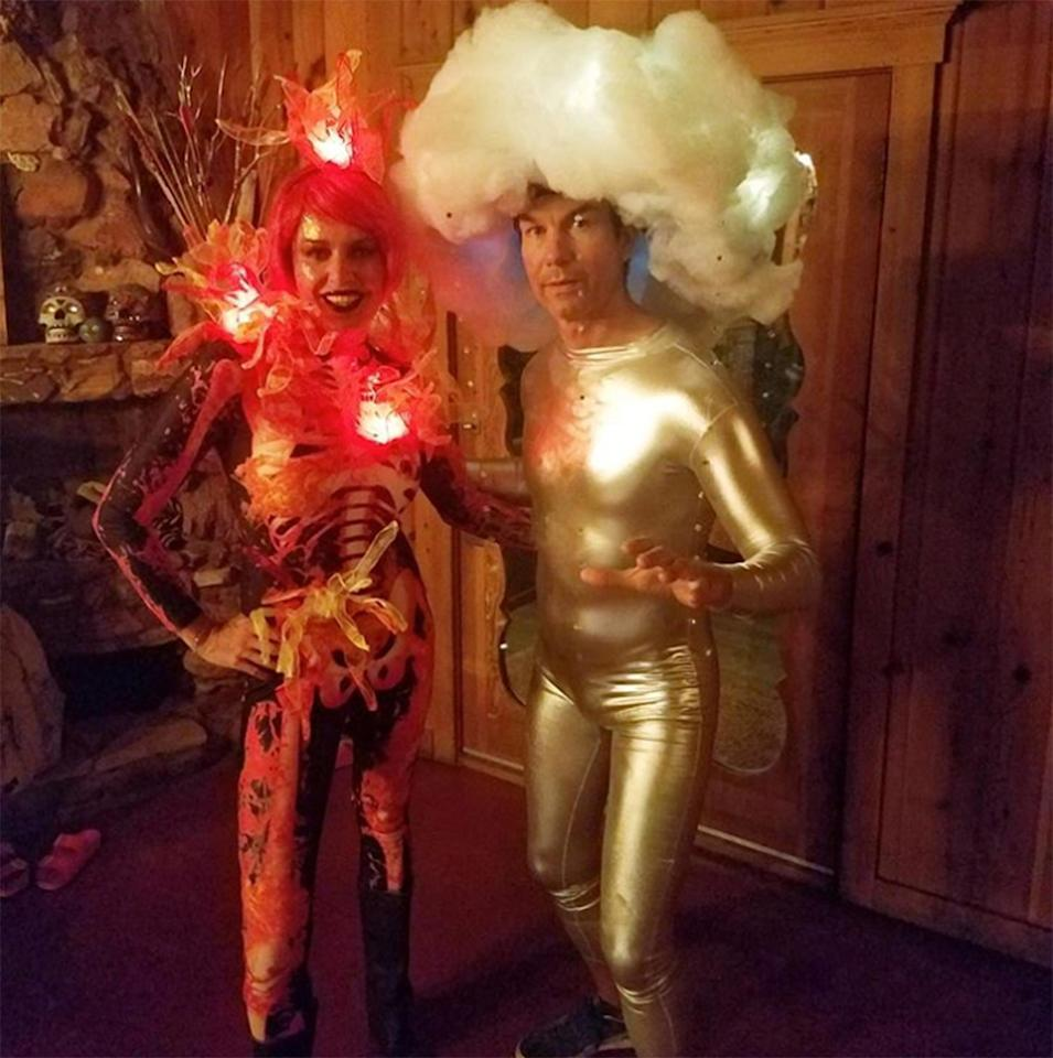 The cool couple heated things up with their incredible rain and fire costumes.