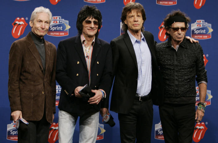 FILE - Members of the Rolling Stones, from left, drummer Charlie Watts, guitarist Ron Wood, singer Mick Jagger, and guitarist Keith Richards. pose for photographers after arriving for a Super Bowl news conference in Detroit on Feb. 2, 2006. Watts' publicist, Bernard Doherty, said Watts passed away peacefully in a London hospital surrounded by his family on Tuesday, Aug. 24, 2021. He was 80. The Rolling Stones were the halftime entertainment at Super Bowl XL foorball game between Pittsburgh Steelers and the Seattle Seahawks. (AP Photo/Michael Conroy, File)