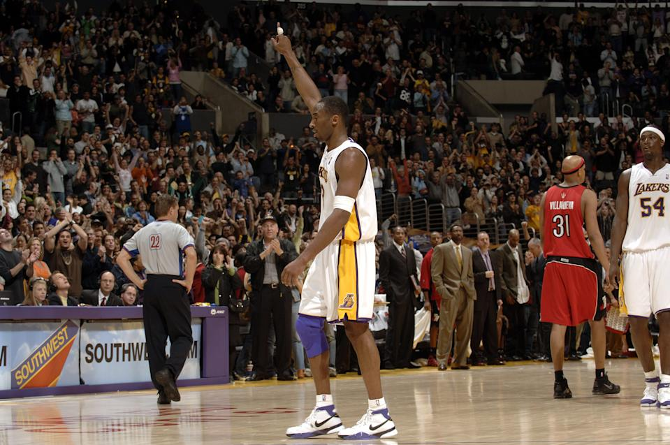 Kobe Bryant acknowledged the Staples Center crowd during his 81-point game against the Toronto Raptors in January 2006. Bryant's single-game scoring total is second in NBA history only to Wilt Chamberlain's 100-point game. (Noah Graham/NBAE via Getty Images)
