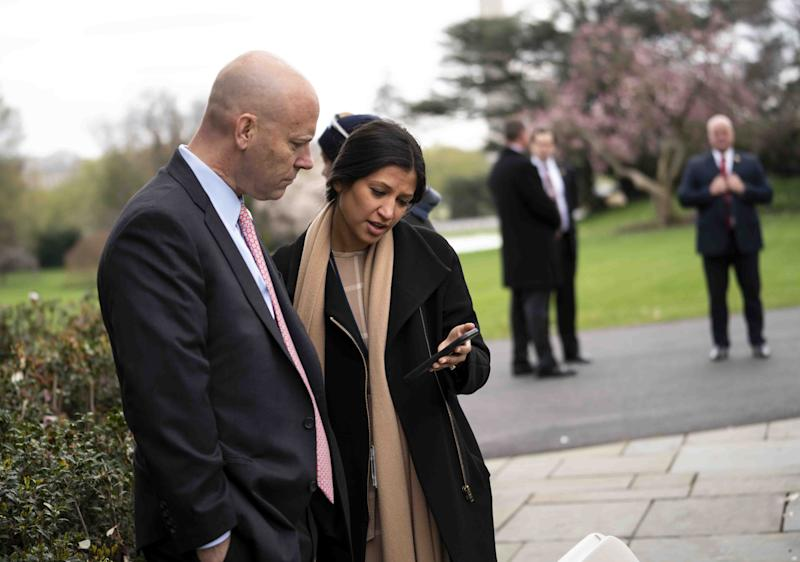 Katie Miller, press secretary for Vice President Mike Pence, talks with Pence's chief of staff, Marc Short, in the White House Rose Garden. Miller has tested positive for coronavirus.