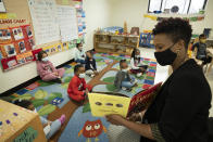 """FILE — In this March 24, 2021 file photo, Melissa Jean reads """"The Gruffalo"""" to her son's pre-K class at Phyl's Academy, in the Brooklyn borough of New York. New York City schools will be all in person this fall with no remote options, Mayor Bill de Blasio announced Monday, May 24. (AP Photo/Mark Lennihan, Pool, File)"""