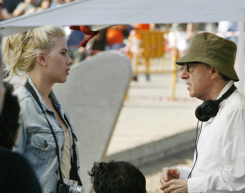 """U.S. film director Woody Allen, right, gives instruction to U.S. actress Scarlett  Johansson on the first day's filming of his new movie in Barcelona, Spain, Monday July 9, 2007.  Woody Allen has said he hopes to create a portrait  of the northeastern Spanish city of Barcelona on a par with his 1979 film, """"Manhattan."""" The movie, starring Scarlett Johansson, Penelope Cruz and Javier Bardem,  is not yet titled. (AP Photo/Manu Fernandez)"""