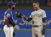 Seattle Mariners' Mallex Smith, right, jokes with Texas Rangers shortstop Danny Santana after stealing second base during the fifth inning of a baseball game Thursday, Aug. 29, 2019, in Arlington, Texas. (AP Photo/Louis DeLuca)