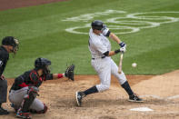 New York Yankees' DJ LeMahieu hits a two-run double during the sixth inning of a baseball game against the Miami Marlins at Yankee Stadium, Saturday, Sept. 26, 2020, in New York. (AP Photo/Corey Sipkin)