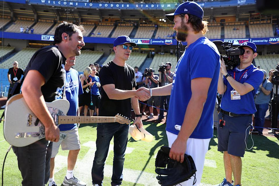 <p>Clayton Kershaw #22 of the Los Angeles Dodgers talks with Brad Paisley prior to Game 2 of the 2017 World Series against the Houston Astros at Dodger Stadium on Wednesday, October 25, 2017 in Los Angeles, California. (Photo by Alex Trautwig/MLB Photos via Getty Images) </p>
