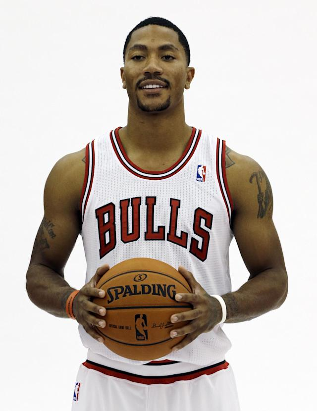 Chicago Bulls guard Derrick Rose poses for a photographer during NBA basketball media day at the Sheri L. Berto Center, Friday, Sept. 27, 2013., in Deerfield, Ill. (AP Photo/Nam Y. Huh)