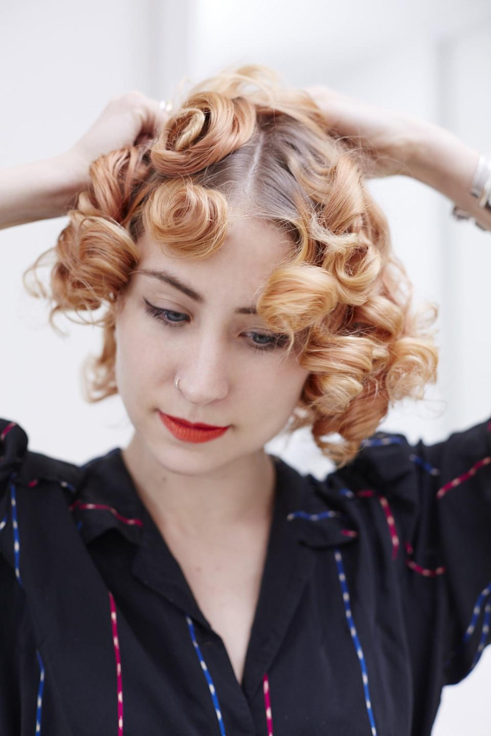 <p>Use your fingers to smooth out the curls.</p>