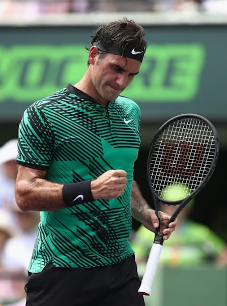 Roger Federer of Switzerland celebrates acoring a point against Rafael Nadal of Spain during their Miami Open Final match, at Crandon Park Tennis Center in Key Biscayne, Florida, on April 2, 2017
