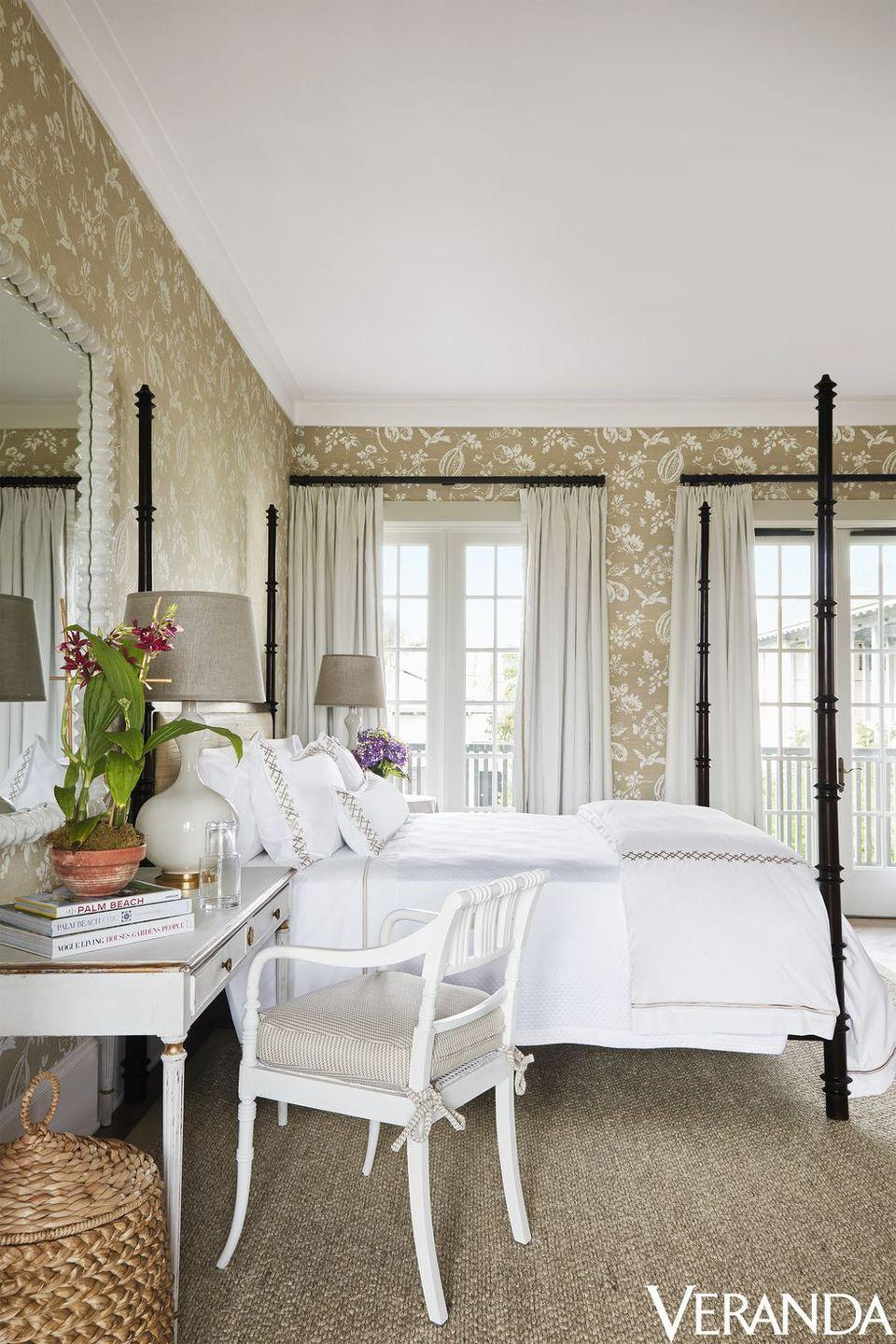 """<p>Designer Alessandra Branca embraces the beachy and relaxing setting of this <a href=""""https://www.veranda.com/decorating-ideas/a19833976/alessandra-branca-windsor-florida-village-suites/"""" rel=""""nofollow noopener"""" target=""""_blank"""" data-ylk=""""slk:Florida bedroom"""" class=""""link rapid-noclick-resp"""">Florida bedroom</a> by covering the walls in a delightfully patterned <a href=""""https://fave.co/2L3dtIf"""" rel=""""nofollow noopener"""" target=""""_blank"""" data-ylk=""""slk:Brunschwig & Fils"""" class=""""link rapid-noclick-resp"""">Brunschwig & Fils</a> cotton. Bed linens from <a href=""""https://go.redirectingat.com/?id=74968X1525088&xs=1&url=https%3A%2F%2Fwww.sferra.com%2Fcasa-branca-sferra&sref=https%3A%2F%2Fwww.veranda.com%2Fdecorating-ideas%2Fa19833976%2Falessandra-branca-windsor-florida-village-suites%2F"""" rel=""""nofollow noopener"""" target=""""_blank"""" data-ylk=""""slk:Casa Branca for Sferra"""" class=""""link rapid-noclick-resp"""">Casa Branca for Sferra</a> envelop the four-poster <a href=""""https://fave.co/2L48Ldj"""" rel=""""nofollow noopener"""" target=""""_blank"""" data-ylk=""""slk:Oly"""" class=""""link rapid-noclick-resp"""">Oly</a> bed. The cushion of the vintage chair is in a <a href=""""https://fave.co/2DAuDqt"""" rel=""""nofollow noopener"""" target=""""_blank"""" data-ylk=""""slk:Dedar"""" class=""""link rapid-noclick-resp"""">Dedar</a> fabric. </p>"""