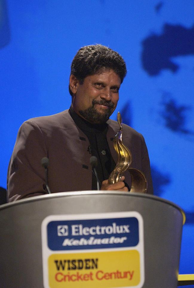 LONDON - JULY 23:  Kapil Dev of India with the Wisden Cricketer of the Century Trophy during the Indian Wisden Cricketer of the Century Awards at Wembley Conference Centre in London on July 23, 2002. (Photo By Stephen Munday / Getty Images)