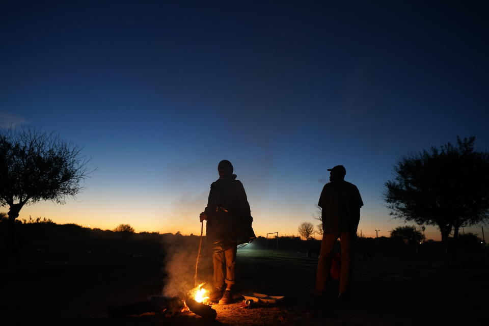 Migrants trying to reach the U.S., many from Haiti, camp out in Ciudad Acuna, Mexico, at dawn Thursday, Sept. 23, 2021, across the Rio Grande river, the natural border with Del Rio, Texas. (AP Photo/Fernando Llano)