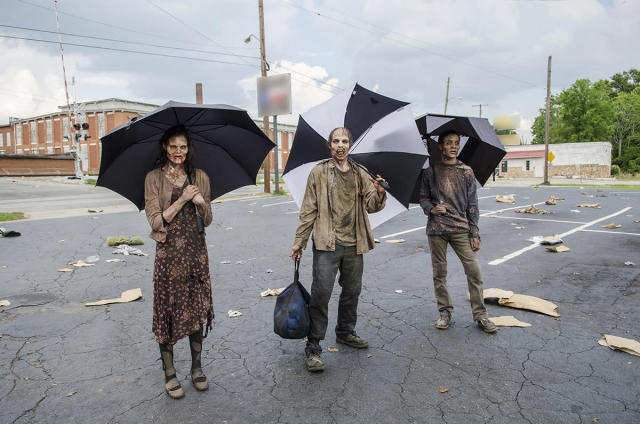 <p>Probably not, but even the undead — or those who play them on TV — need some protection from that summer Atlanta heat on <em>The Walking Dead</em> set. (Photo: AMC) </p>