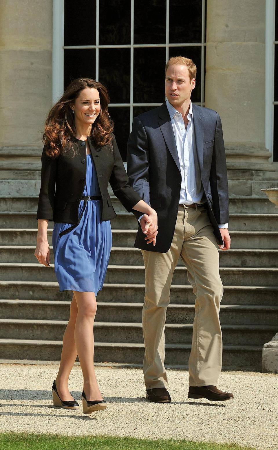 <p>Kate and William leave Buckingham Palace the day after their wedding with the Duchess dressed in a casual blue Zara dress with patent L.K. Bennett wedges and a simple black jacket. </p><p><i>[Photo: PA]</i></p>