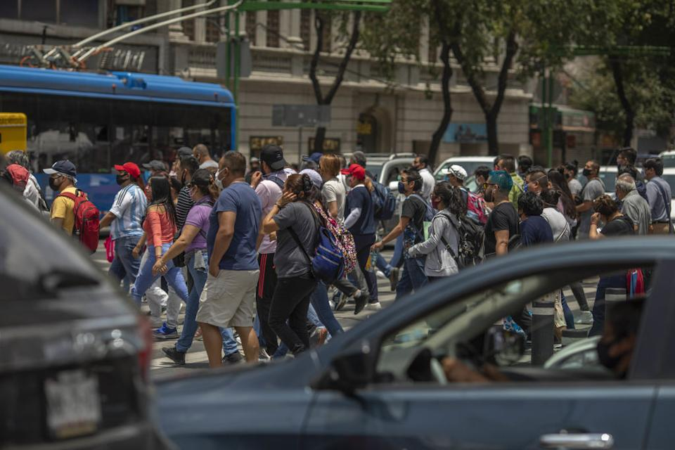 Dozens of pedestrians cross Eje Central Avenue in Mexico City on Wednesday.
